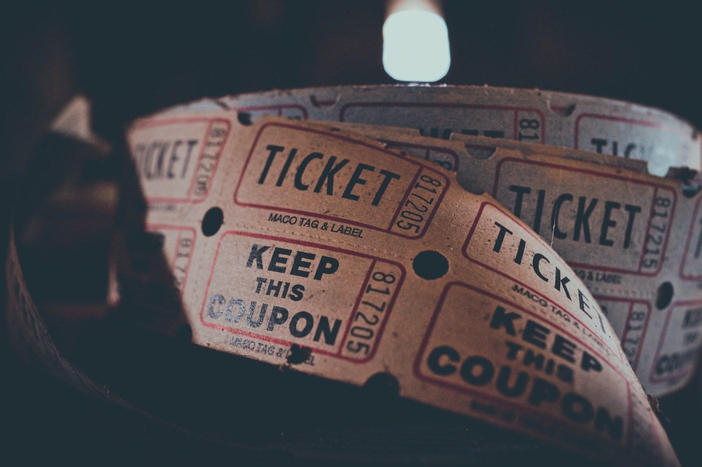 An old school reel of cinema style tickets.