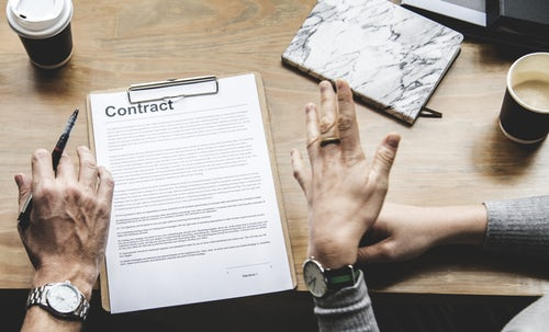 a contract attached to a clipboard