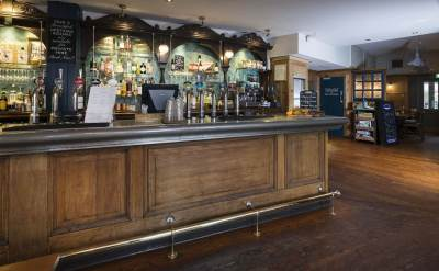 Bar area with wooden flooring and wooden bar