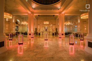 A grand ballroom in London with an atrium in the middle and subtle orange lighting