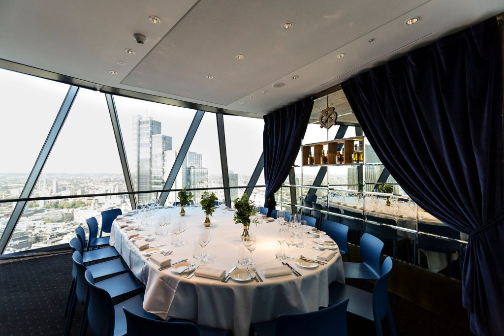 A meetign room in The Gherkin in London full of natural daylight.
