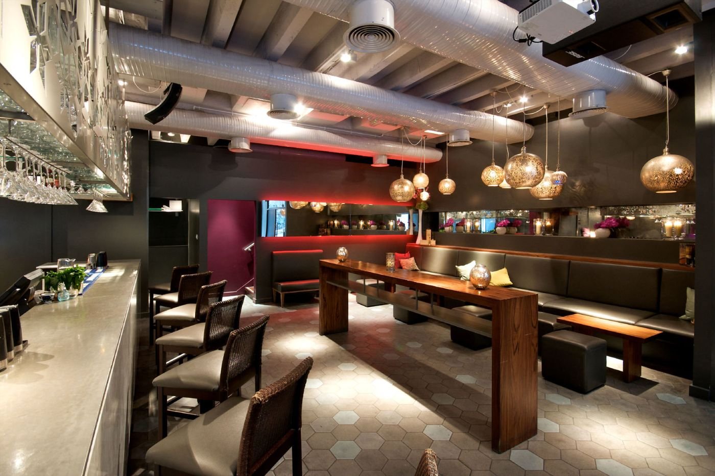 A bar with long wooden tables in the middle
