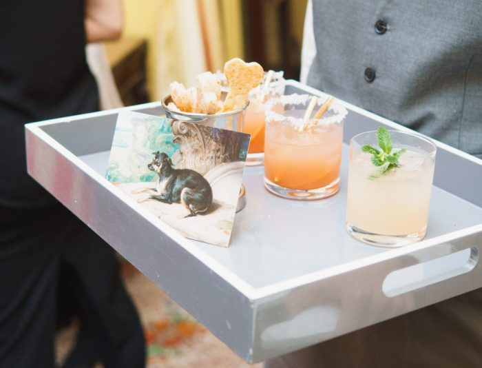 Waiter holding tray of cocktails.