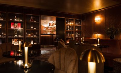 Modern bar with dark lighting and contemporary light fixtures