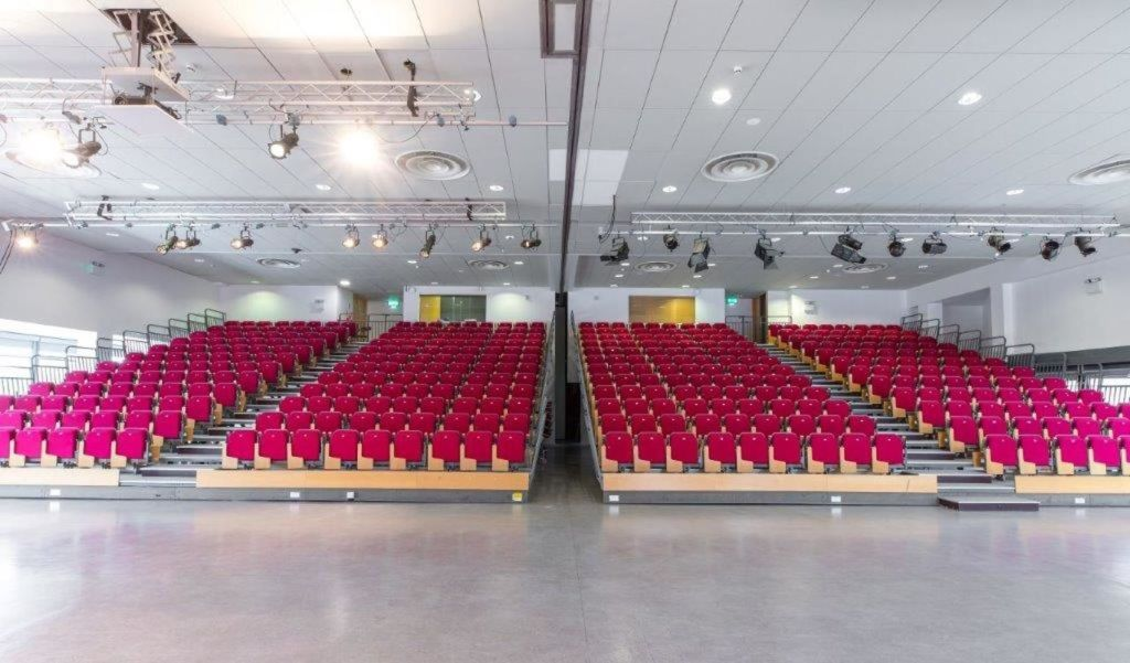 large auditorium with red tiered seating