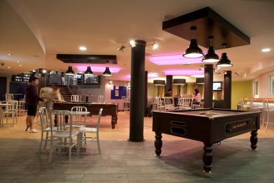 Open games room with chairs and pool table.