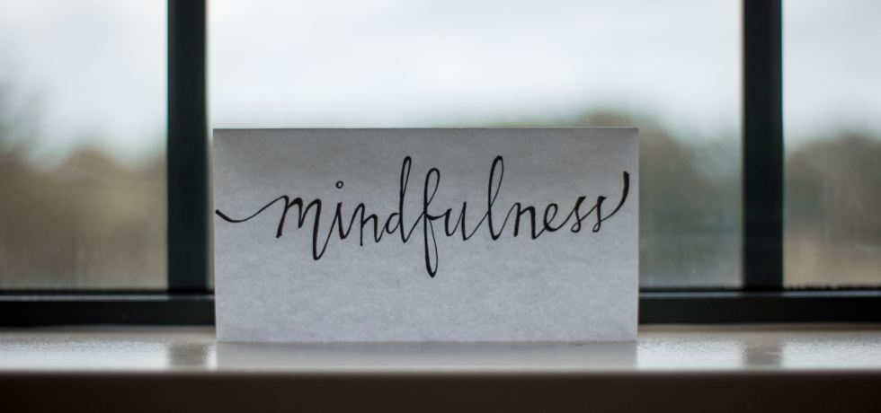 A handwritten note by a window reading 'Mindfulness'