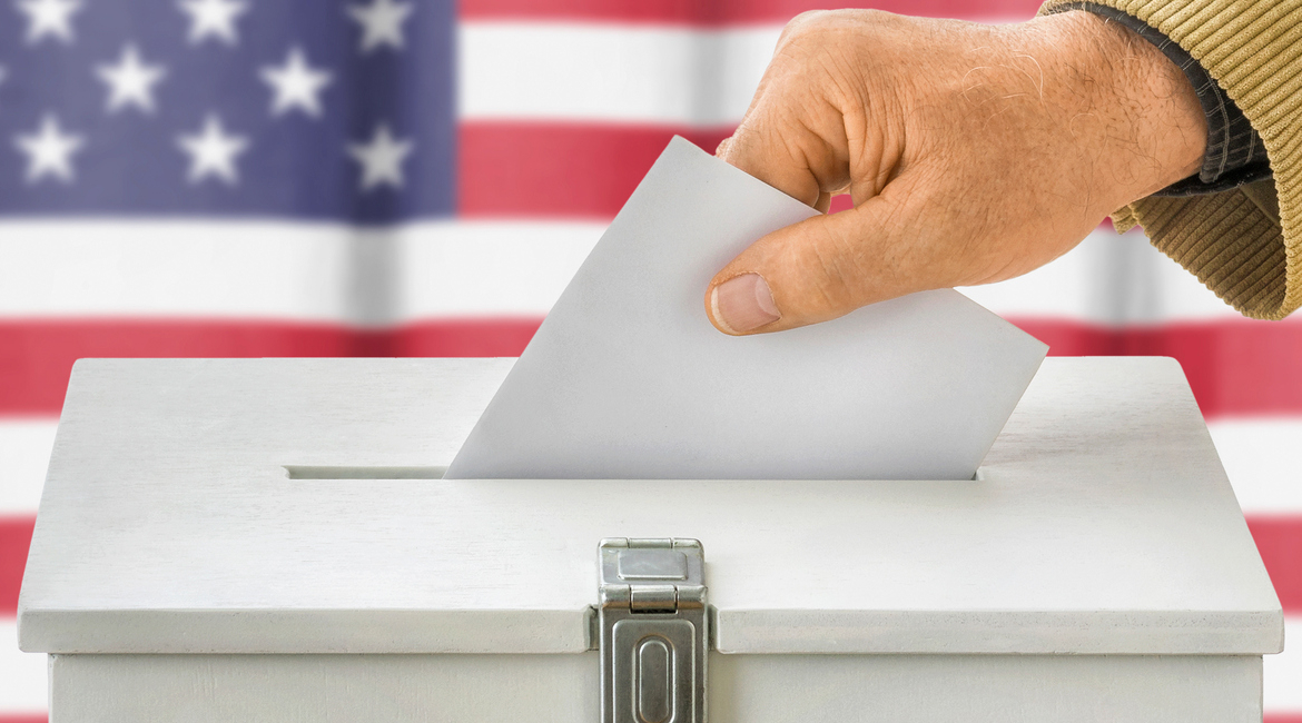 Man putting a ballot into a voting box - USA, vote, election