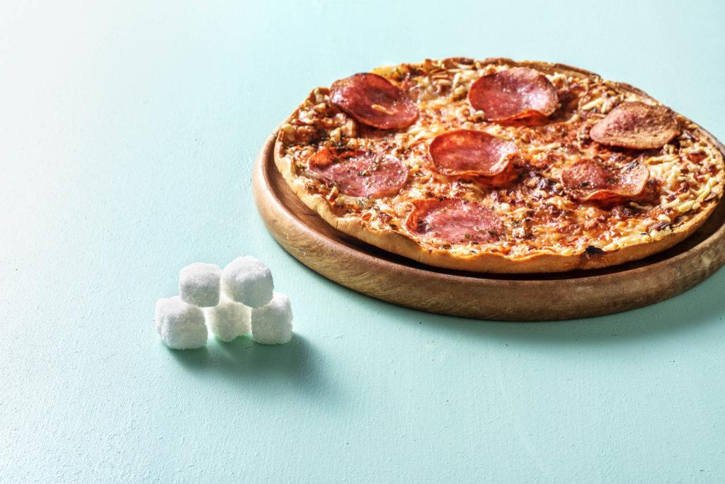 Zucker in Pizza