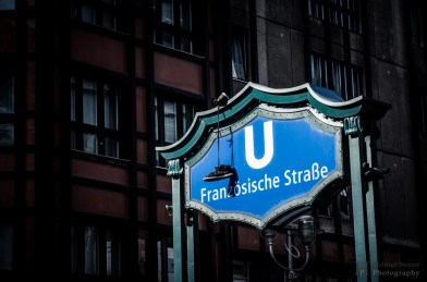 Subway sign of Französische Straße in Berlin with shoes hanging down of it