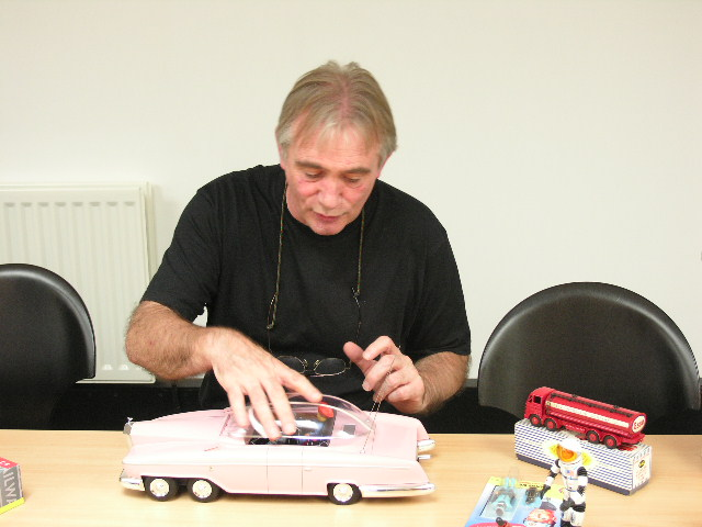 Martin Hills showing some of his toys
