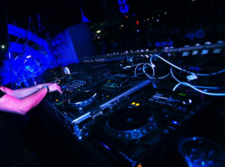 DJ turntable with a dancing crowd
