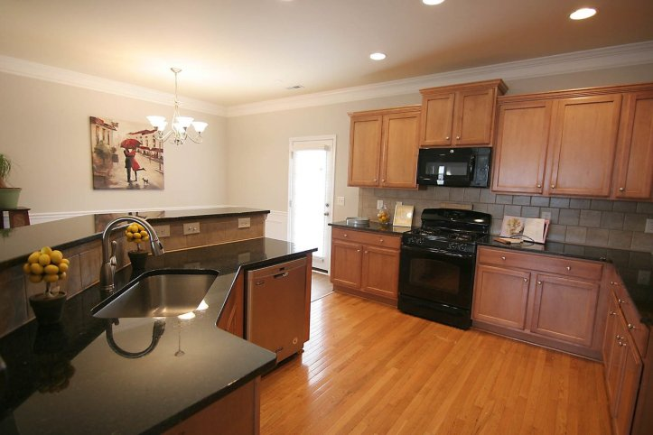 gourmet kitchen at 226 presenteer trail, an apex townhome