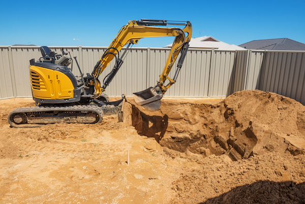 excavation process installing in-ground pool
