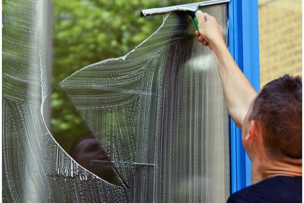 window cleaner cleaning window exterior