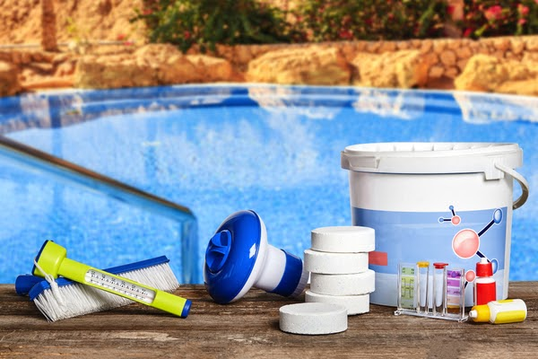 pool cleaning supplies on edge of pool