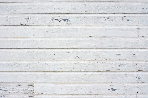 siding showing signs of old age and repairs needed