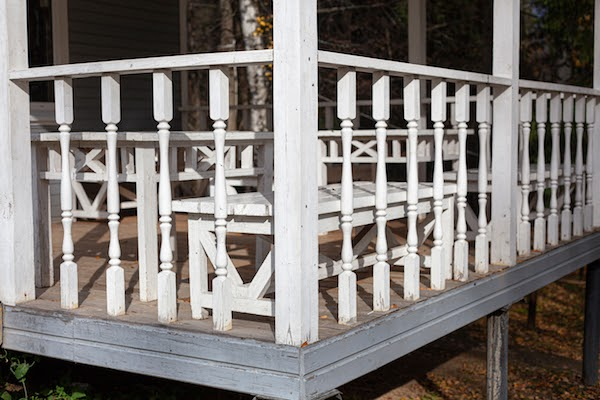 front porch of home with old railings