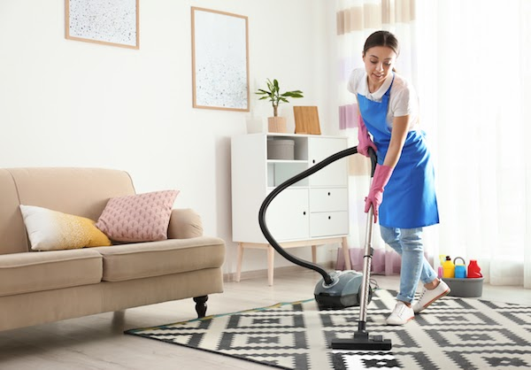 professional cleaning company cleaning a condo