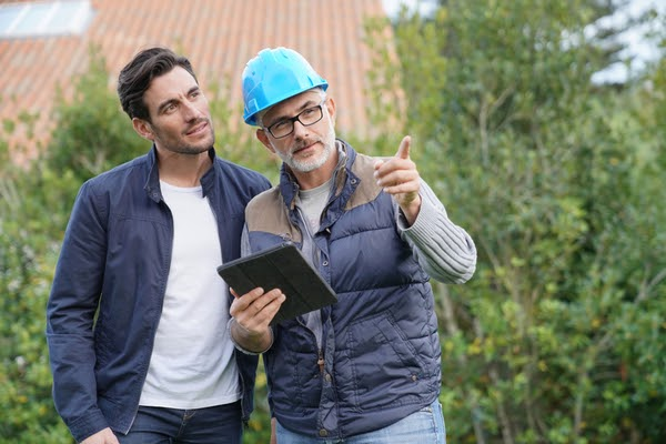 contractor and homeowner reviewing project