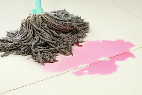 dirty mop cleaning up spill