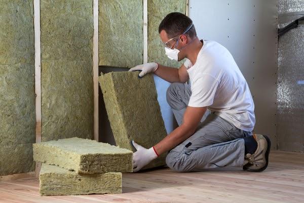 fibreglass batts insulation being installed