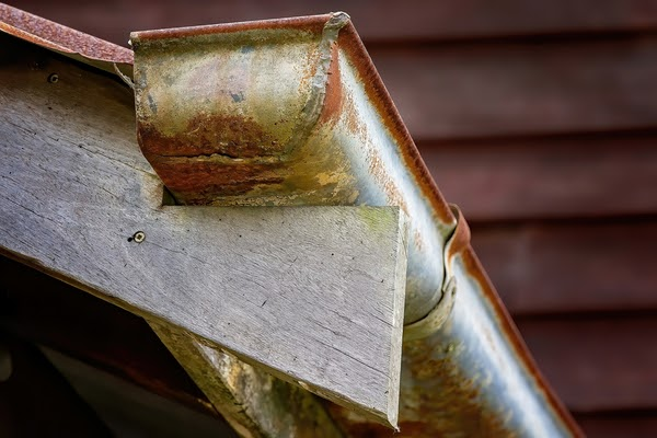 peeling paint on eavestroughs and gutters
