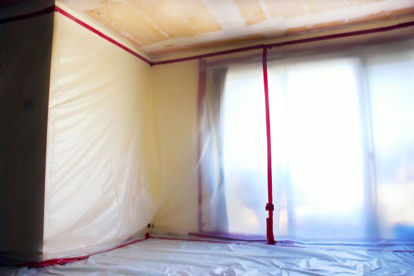 plastic sheeting hung in room
