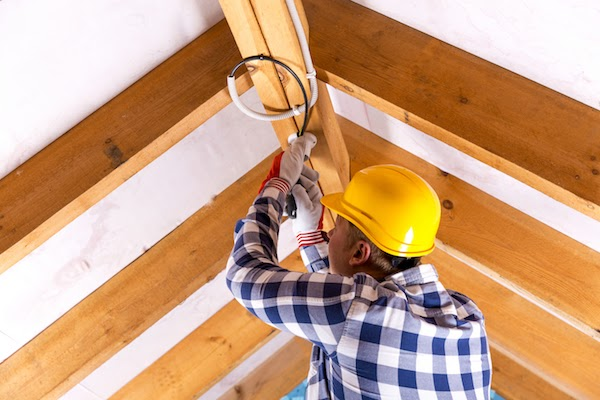 master electrician rewiring attic