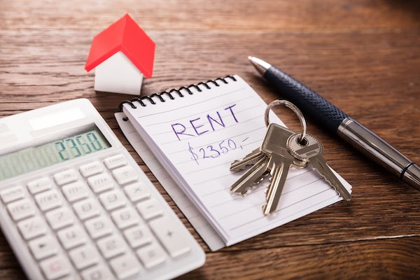 calculator and note pad calculating rent