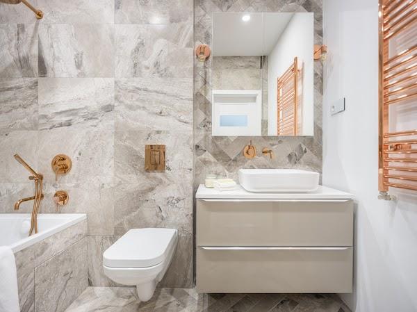 beautiful grey and copper bathroom renovation
