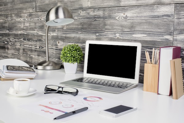video-call friendly desk with lamp and laptop