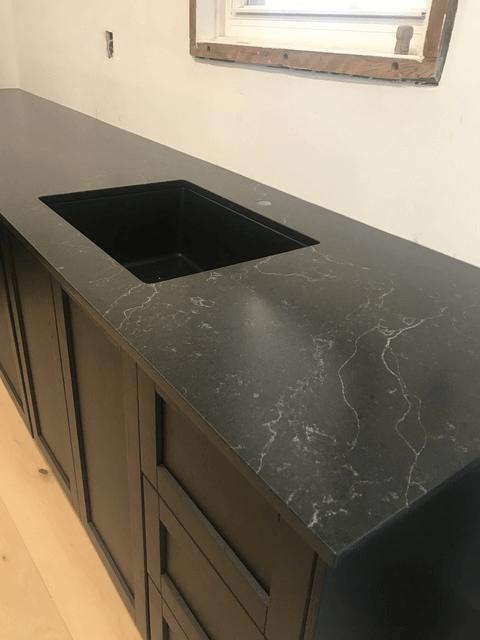 black kitchen countertop installation