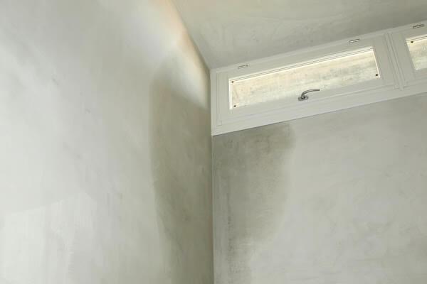 room with water leak in corner of ceiling