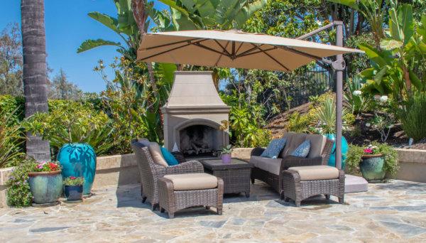 Backyard Patio with Fireplace and big umbrella