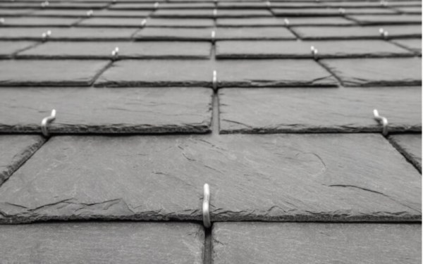 Background slates laid on roof close up rectangle double roofing