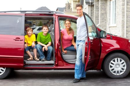 7088156 - smiling happy family and a family car