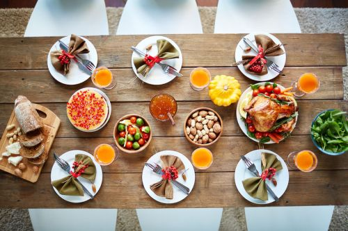 47436757 - roasted poultry, glasses with juice, vegetables, nuts and tableware on served table