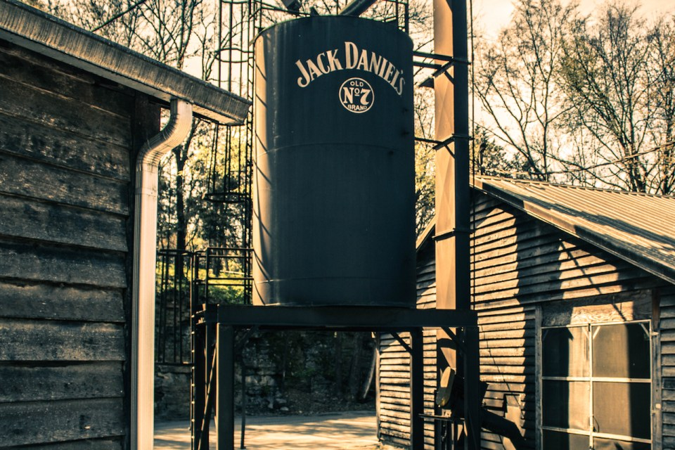 Sepia colored photo of the outside of Jack Daniel's distillery in Nashville, Tennessee