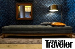 Conde Nast Traveler logo on a photo of a hotel bedroom