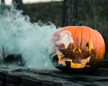 Smoke coming out of the face of a carved Pumpkin