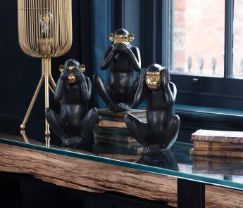 Black and gold monkeys on table