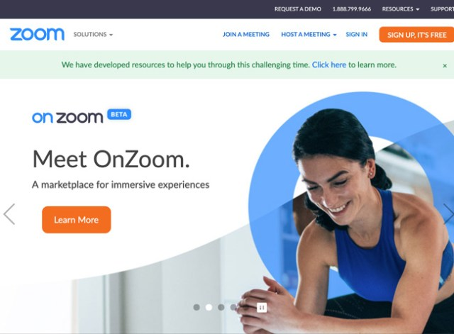 Zoom Website homepage that shows a woman finishing a workout and text that reads meet on zoom a marketplace for immersive expereinces