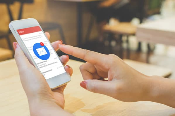 A person opens an email after opting in to Apple IOS 15 privacy features.