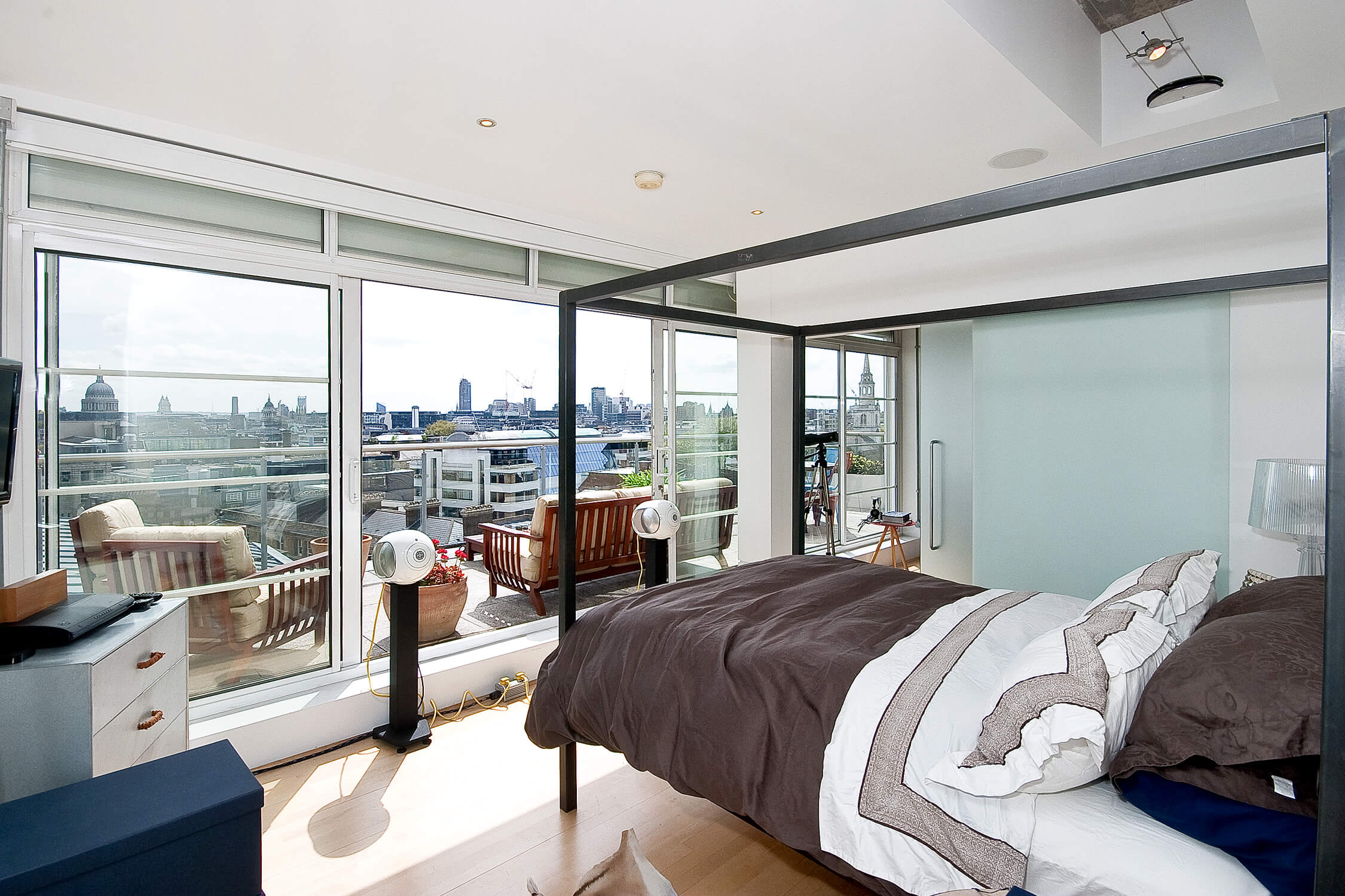 A stunning two bedroom lateral sub-penthouse with wraparound terrace