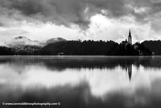 Morning at Lake Bled's island church of the assumption of saint mary after a night of heavy summer rain, Slovenia.