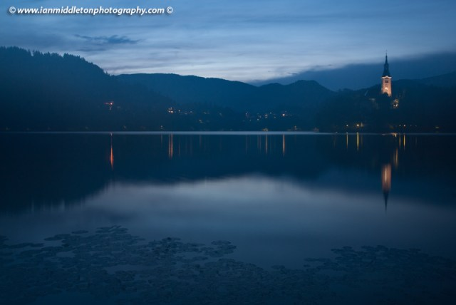 View across the beautiful Lake Bled, island church at dusk, Slovenia. Photo taken with lens misted up to show effect.