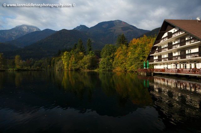 Autumn colours reflected over Jezero Črnava (black lake), Hotel Bor in Preddvor, Gorenjska, Slovenia.