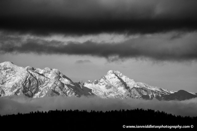 Interesting cloud formation over the Kamnik Alps in black and white, Slovenia.