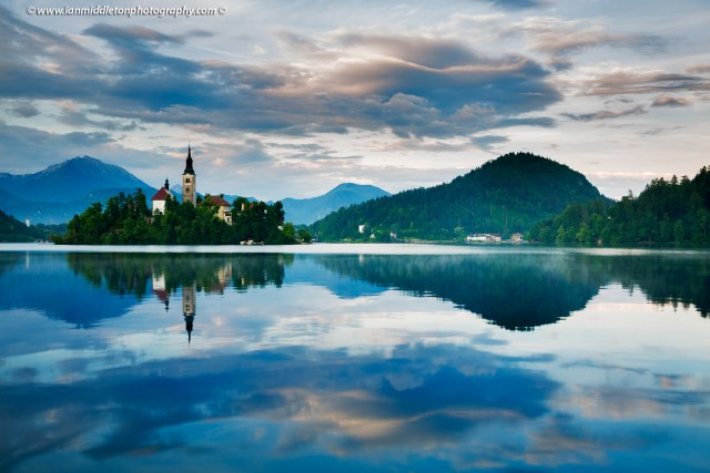 View across the beautiful Lake Bled, island church at sunset with the beautiful Karavank mountains in the background, Slovenia. Lake Bled is Slovenia's most popular tourist destination and the Karawanke mountains form the border between Slovenia and Austria.